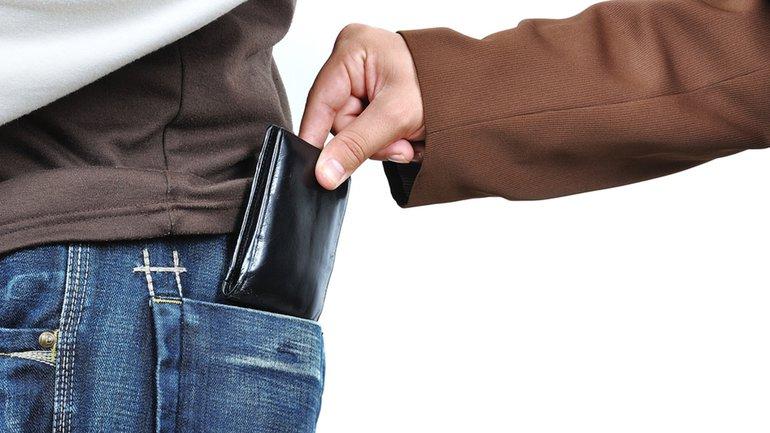 Taschendieb Geldbeutel Hand